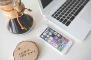 desk coffee chemex phone laptop