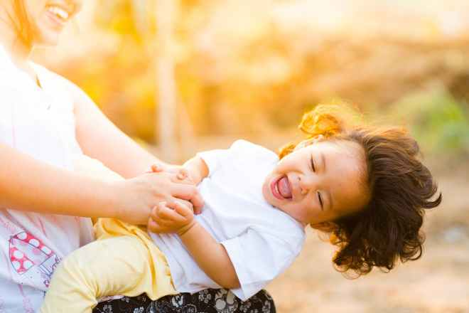 woman holding baby smiling