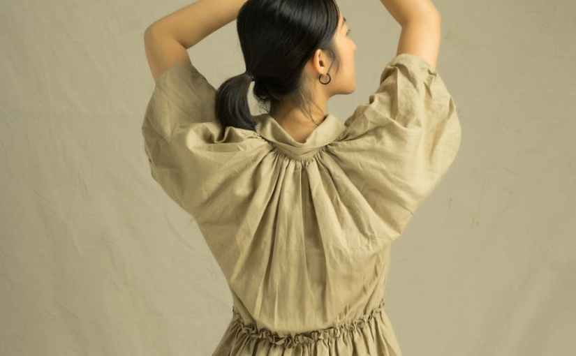 back view of a woman in brown dress